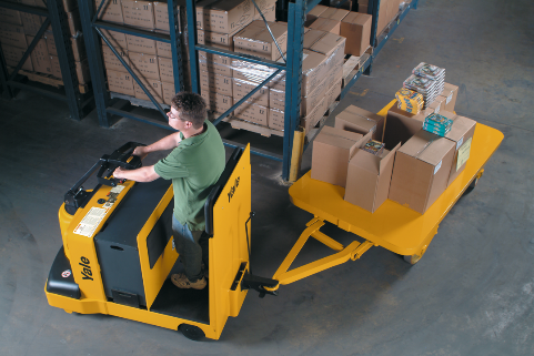 Man operating a forklift to move boxes